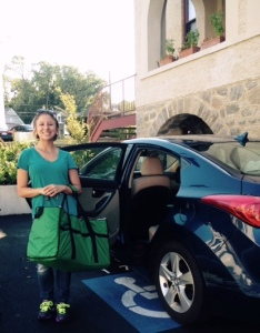 Volunteer Food Runner Tasha gets ready to pick up food with her insulated bag. She can use CFR's new mobile app to accept food runs on the fly.