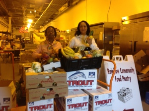 Pat Drumming and helper sort through Coastal Sunbelt's produce donation