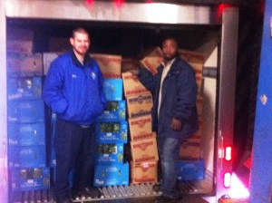 Loading Rainbow CDC's refrigerated truck at Coastal Sunbelt--6 pallets for donation!