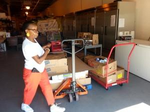 Barbara at Rainbow CDC receiving food donation
