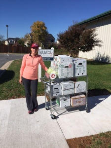 Volunteer food runner Tammi delivers rescued fresh produce from From the Earth Food LLC to WUMCO-HELP Inc.
