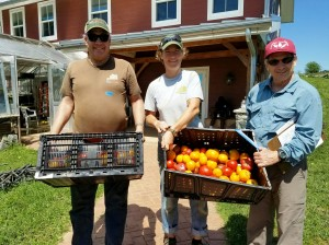 Volunteer Food Runner Bill (red cap) received donation from Red Wiggler Community Farm