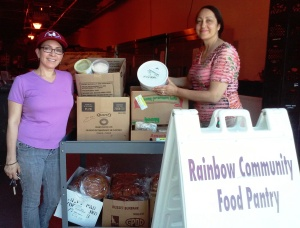 Volunteer Food Runner Lila delivers frozen food to Pat at Rainbow Community Development Center
