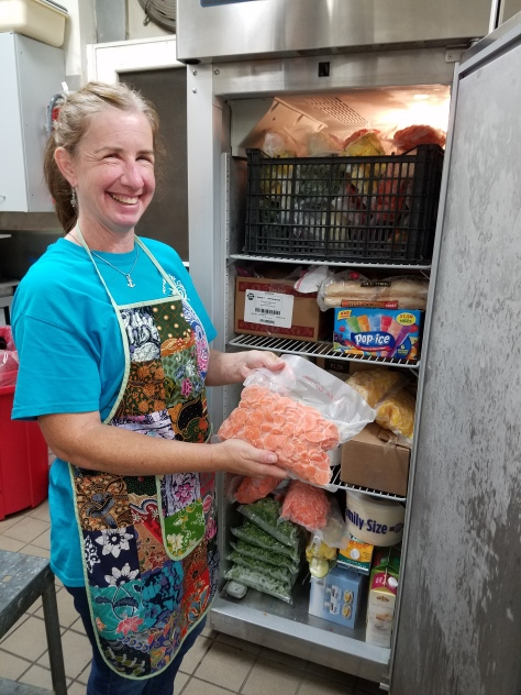Susan Burgess can now process and freeze recovered fresh local produce in the new commercial freezer purchased with a CFR mini-grant.