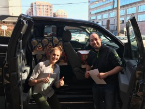 Volunteers transport food from donor businesses to food assistance organizations.